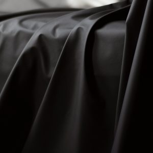 Black Fluidproof sheet showing drapes and folds