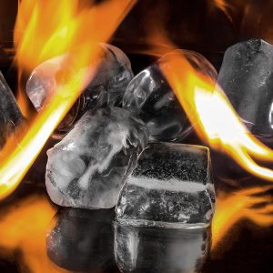 Temperature Play image of ice cubes being licked by orange flames